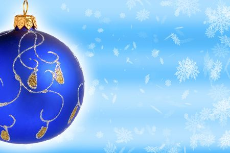 Blue christmas ball on snow background photo