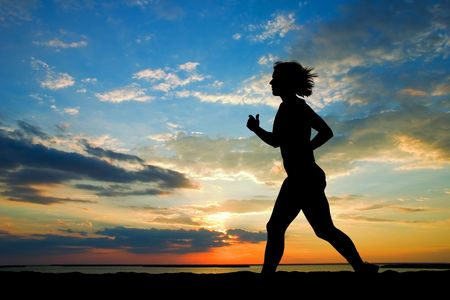 persevere: A woman running on the beach