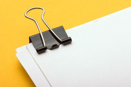 retrieve: view of a paper clip with stack of blank paper