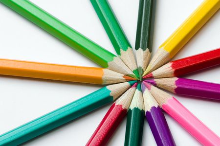 thick colored pencils against a white background color  photo