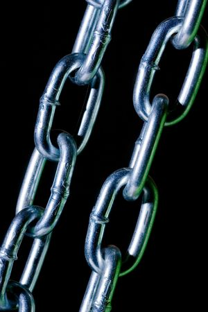 chainlinks: The New Metal Chain on black Stock Photo