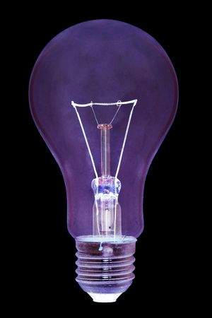 closeup of lightbulb on black background. Negative Stock Photo - 653774