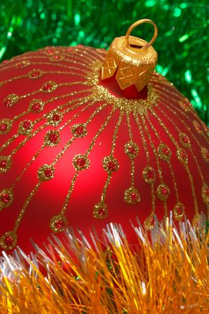 Christmas decoration on silver tinsel background photo