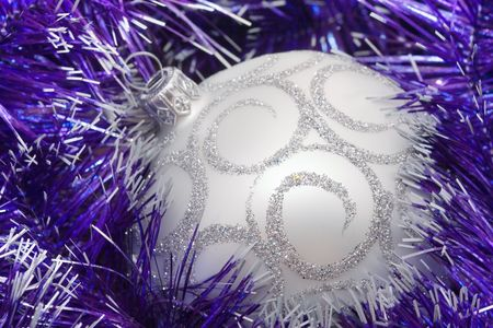 Christmas decoration on the color tinsel background photo
