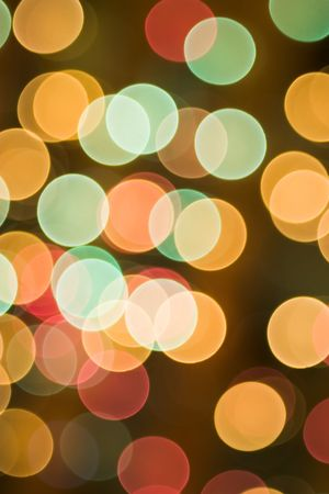 Brightly colored Christmas lights on a Christmas tree. Forced out of focus.  photo