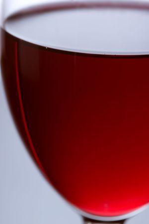 The close up of the red wine glass photo