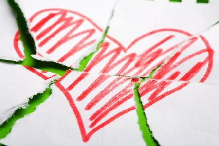 Heart drawn on torn notebook page photo