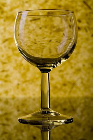 The close up of the wine glass on color background photo