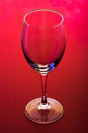 The close up of the wine glass on red  photo