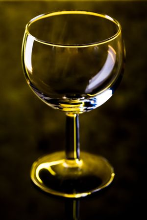The close up of the wine glass on black photo