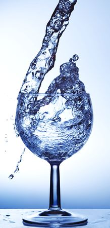 Water being poured into a wine glass Stock Photo - 799090