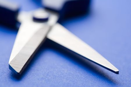 shears: open shears on blue background. Small DOF