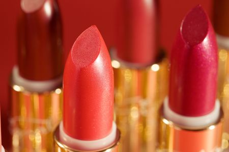close-up of a lipstick against a black background photo