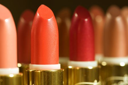 close-up of a lipstick against a color background photo