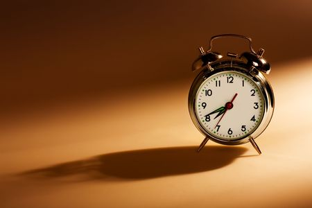 close up of the oldfashioned alarm clock photo