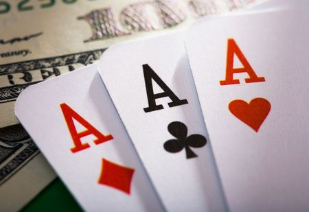 playing with money: the close up of the poker cards
