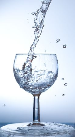 Water being poured into a wine glass   photo