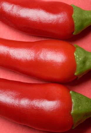 descriptive: Close up view of red hot chilli peppers