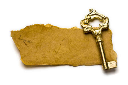 Close up view of the old key on old paper  photo