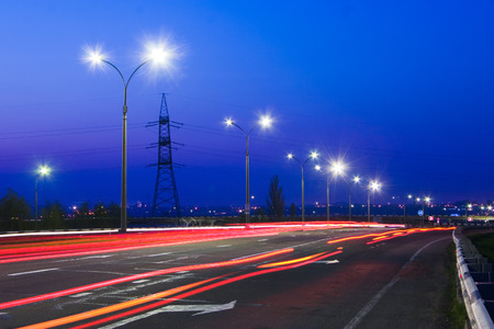 nightfall: Motorway, traffic at nightfall. Vivid color. Dark blue sky Stock Photo