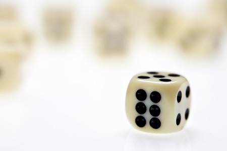 close up view of three dice on white photo