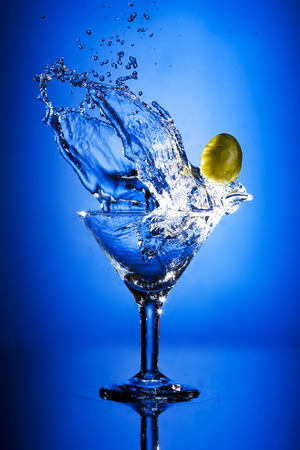Close up view of the splash martini on blue