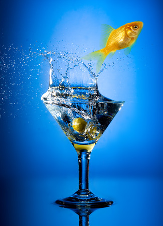 Close up view of the splash martini on blue photo