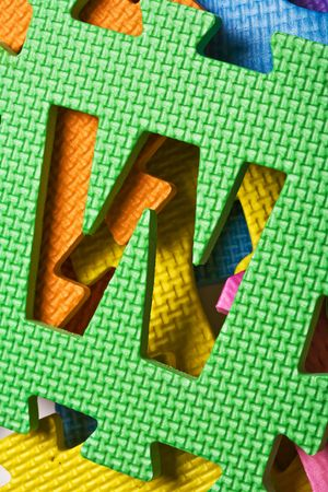 learing: Close up view of the letter W on the color background