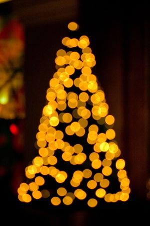 Brightly colored Christmas lights on a Christmas tree. Forced out of focus.r photo