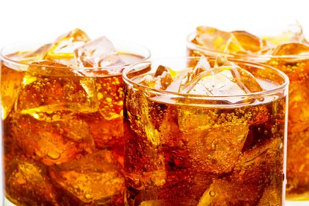 Close up view of the cola and ice in glass