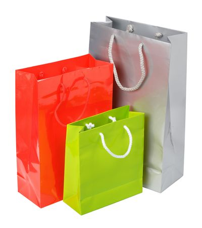 commercial recycling: color paper bags isolated on white background