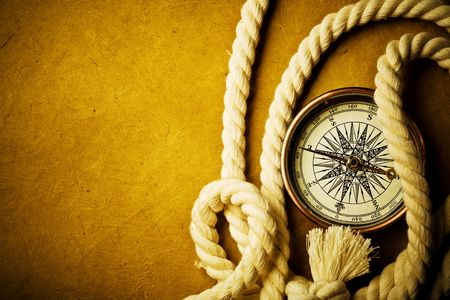 nautical vessels: Close up view of the compass on old paper Stock Photo