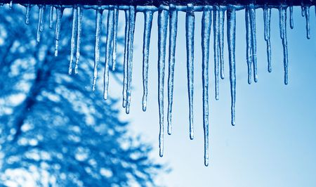 dilute: Close up view of the some icicles with a blue duo-tone effect Stock Photo