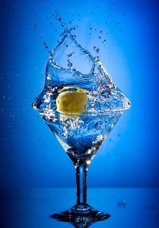 martini splash: Close up view of the martini splash on blue
