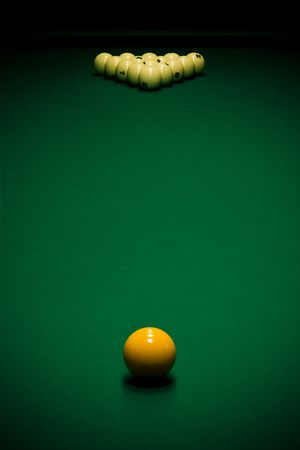 night table: Yellow sphere on a billiard table in a night club Stock Photo