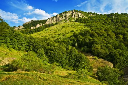 Green hill with blue sky. Summer landscape Stock Photo - 2934339