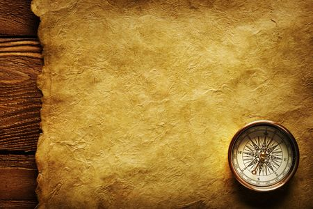 Close up view of the Compass on the old paper background photo