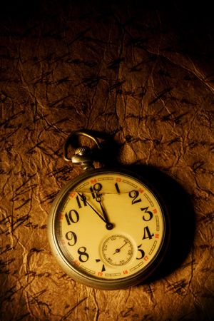 collectable: Close up view of the Pocket clock on old paper Stock Photo