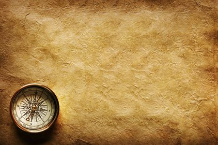 nautical map: Close up view of the Compass on the old paper background Stock Photo