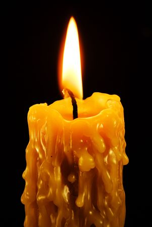candlelight memorial: Close up view of the candle cutting through the darkness.