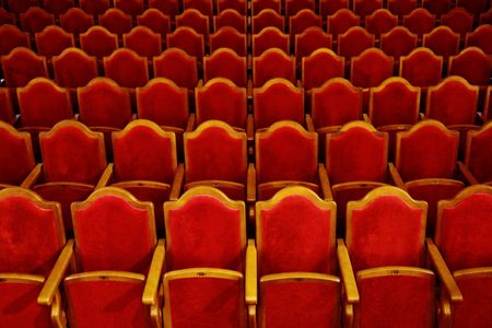 Photograph of the Rows of theatre seats Stock Photo