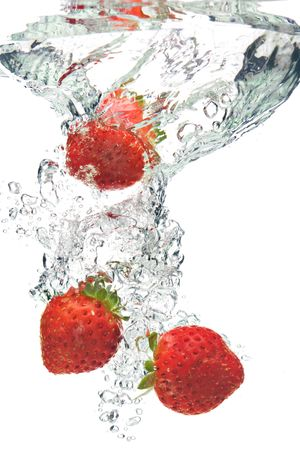 A background of bubbles forming in water after strawberries are dropped into it. photo
