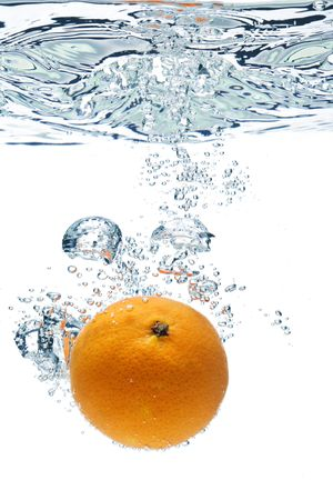 A background of bubbles forming in blue water after orange are dropped into it. Stock Photo - 3522764