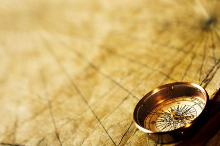 south west: Close up view of the Compass on the old paper background Stock Photo