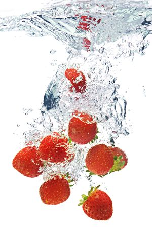 juice splash: A background of bubbles forming in water after strawberries are dropped into it. Stock Photo