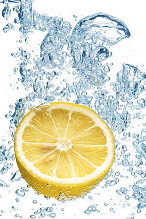 citron: A background of bubbles forming in blue water after lemon is dropped into it. Stock Photo