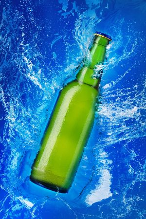 beer bottle being poured in a water photo