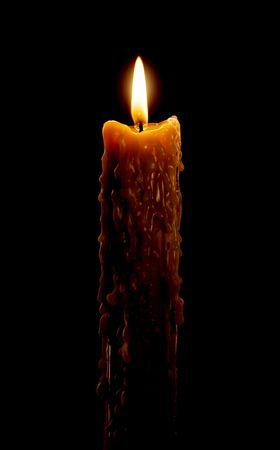 cutting through: Close up view of the candle cutting through the darkness.