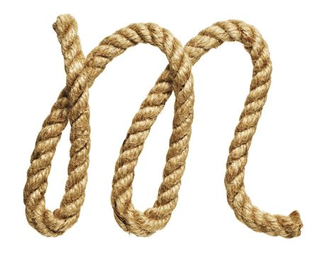 old natural fiber rope bent in the form of letter M photo