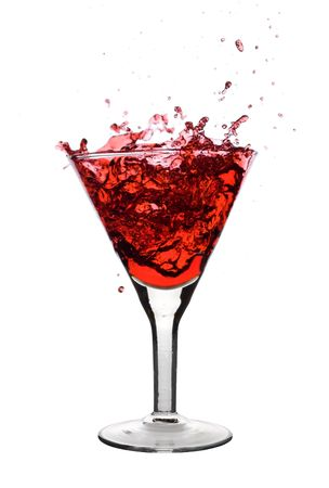 Red Martini being poured in a martini glass;  Stock Photo